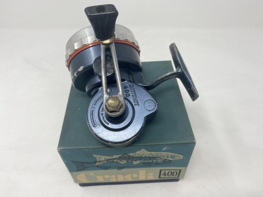 Stationärrolle, Crack 400, Blau, Spulenschutzschraube Alu, technisch in Ordnung, Gebrauchsspuren. im Originalkarton